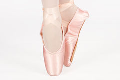 A ballet dancer standing on toes while dancing artistic conversi Stock Image