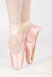 A ballet dancer standing on toes while dancing artistic conversi Royalty Free Stock Photography