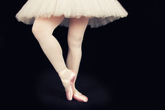 A ballet dancer standing on toes while dancing artistic conversi Royalty Free Stock Photos