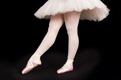 A ballet dancer standing on toes while dancing artistic conversi Royalty Free Stock Images