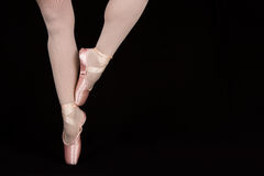 A ballet dancer standing on toes while dancing artistic conversi Stock Photos