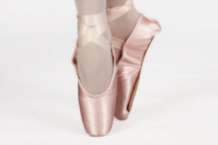 A ballet dancer standing on toes while dancing artistic conversi Royalty Free Stock Image