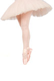 Ballet dancer standing on toes while dancing on white background Royalty Free Stock Photos