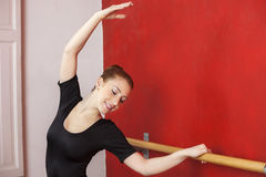 Ballet Dancer Stretching Hand At Barre In Studio Royalty Free Stock Photo