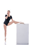 Ballet dancer talking on cellular during rehearsal. Pretty ballet dancer talking on cellular during rehearsal Royalty Free Stock Images