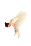 Ballet dancer tightening her dancing shoes Royalty Free Stock Images