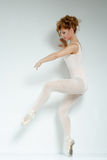 Ballet dancer. Train in the studio. Royalty Free Stock Photography