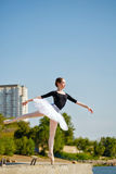 Ballet dancer in tutu dancing on the promenade. Arabesque Royalty Free Stock Images