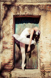 Ballet Dancer. Vintage ballet dancer. Image of a dancer using vintage technique in an old door stock photo