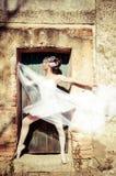 Ballet Dancer. Vintage ballet dancer. Image of a dancer using vintage technique in an old door stock images