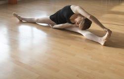 Ballet dancer warming up Stock Photos