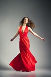 Ballet dancer wearing red dress over grey Royalty Free Stock Photo