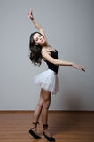 Ballet dancer in white tutu and black top dancing Royalty Free Stock Photos