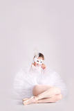 Ballet dancer in a white tutu and a carnival mask Royalty Free Stock Photography