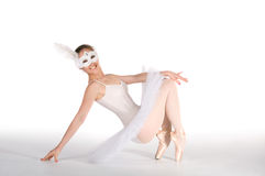 Ballet dancer in a white tutu and a carnival mask Royalty Free Stock Photo