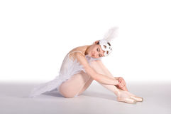 Ballet dancer in a white tutu and a carnival mask Stock Photography