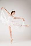Ballet dancer in white tutu posing Stock Photo