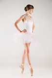 Ballet dancer in white tutu posing Stock Photo