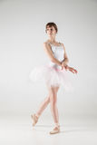Ballet dancer in white tutu posing Stock Photos