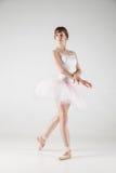Ballet dancer in white tutu posing Stock Photos