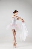 Ballet dancer in white tutu posing Stock Images
