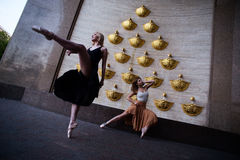 Ballet dancers on the city street royalty free stock photography