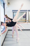 Ballet Dancers create a shape with their legs Royalty Free Stock Photos