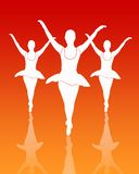 Ballet Dancers Group. Silhouette of ballet dancers Group with dark orange reflective background Stock Images