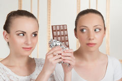 Ballet dancers posing with chocolate Stock Image