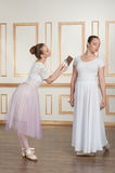 Ballet dancers posing with chocolate Royalty Free Stock Photos