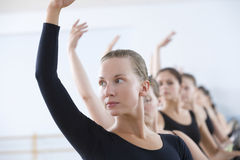 Ballet Dancers Practicing At The Barre Stock Images