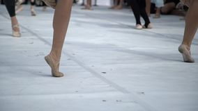 Ballet dancers practicing performance outdoors. Close up of ballerina feet wearing slippers practice moves in ballet class outside.  stock video