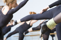 Ballet Dancers Practicing In Rehearsal Room. Group of ballet dancers practicing in rehearsal room Stock Images