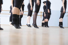 Ballet Dancers Practicing In Rehearsal Room. Low section of ballet dancers practicing in rehearsal room Stock Image