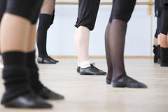 Ballet Dancers Practicing In Rehearsal Room. Low section of young ballet dancers practicing in rehearsal room Stock Photography
