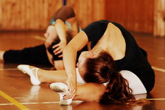 Ballet dancers warm up on gymnasium floor, Revnice, Czech Republic, 25 August 2012 Royalty Free Stock Photo