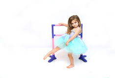 Ballet Dreams. Beautiful little girl practices and stretches for her dance routine.  She is dressed in a ballerina costume of aqua and lilac Stock Photography