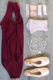 Ballet equipment. On wooden floor Royalty Free Stock Photo