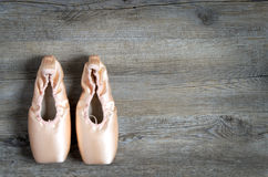 Ballet equipment. On wooden floor Royalty Free Stock Photo