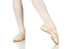 Ballet Feet Positions. Young female ballet dancer showing various classic ballet feet positions on a white background - Point lift, point close. NOT ISOLATED royalty free stock photos