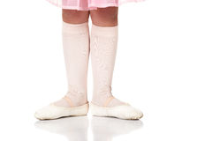 Ballet Feet Positions. Young female ballet dancer showing various classic ballet feet positions on a white background - Beginner 1st position. NOT ISOLATED royalty free stock photos