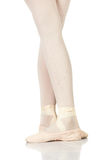 Ballet Feet Positions. Young female ballet dancer showing various classic ballet feet positions on a white background - Fifth position. NOT ISOLATED royalty free stock image
