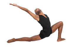 Ballet Flexibility. Male ballet dancer warming up and showing flexibility on white background Royalty Free Stock Photography