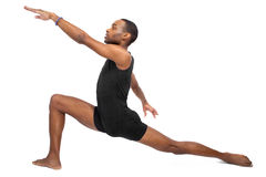 Ballet Flexibility. Male ballet dancer warming up and showing flexibility on white background Stock Photos