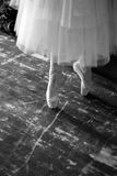Ballet. Fragment of the ballerina`s movement on the pointe shoes in the rehearsal hall of the theater Stock Photos