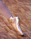 A ballet fragment with little girls legs on pointes.  Stock Photography