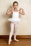 Ballet Girl. Young ballet dancer in a studio with wooden floors Stock Image