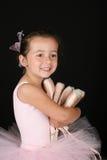Ballet Girl. Cute brunette ballet girl holding lots of pointe shoes Stock Images