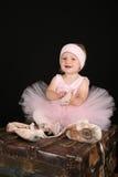 Ballet Girl. Blond toddler wearing a tutu holding Ballet shoes Royalty Free Stock Images