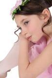 Ballet Girl. Brunette ballet girl against a white background wearing pink Royalty Free Stock Photo